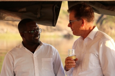 Dr Nyambe Nyambe, Executive Director of KAZA (left) and Dr. Gerd Müller, Minister of Economic Cooperation and Development for the Federal Republic of Germany (right) in Chobe Nature Reserve in Kasane, Botswana
