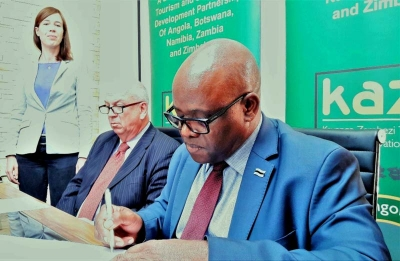 Mr. Thato Raphaka and H.E. Mr. Ralph Breth at the signing ceremony. Looking on is the German Embassy Counsellor for Development Cooperation, Ms. Jana Schlegel.